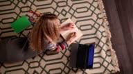 Schoolgirl doing her homework at home. video