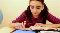 Schoolgirl studying with tablet pc video