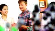 Schoolkids discussing in laboratory video
