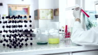 Scientist classifying liquid sample in a laboratory. video