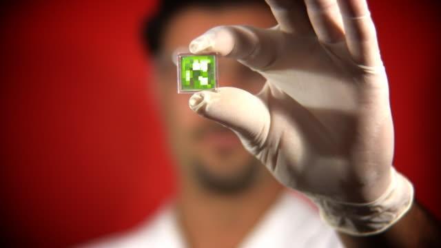 Scientist Examining Micro Processor video