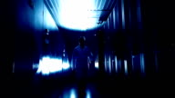 Scientist in data center blue colored video