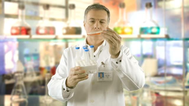 scientist in his lab looking at samples video