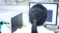 Scientist in sperm laboratory video
