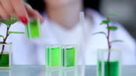 Scientist in the laboratory works with prototipes video