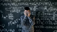scientist man disappointed about problems experiment in chemical and mathematical equations room video