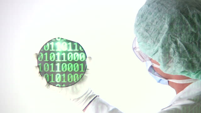 Scientist reviewing Computer Chip Wafer binary code video