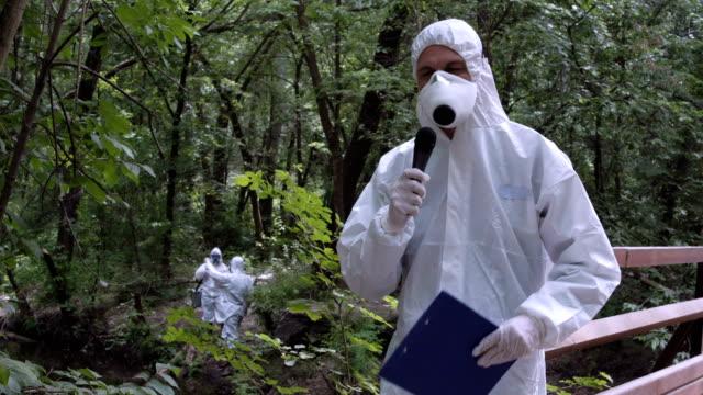 Scientist speaking microphone in woods video