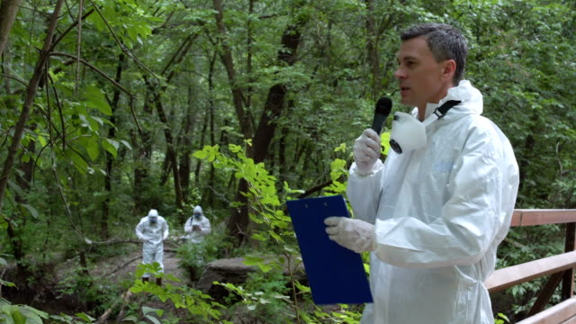 Scientist speaking microphone in woods video