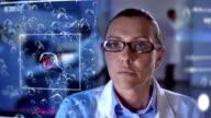 MS Scientist Using A Futuristic Equipment video