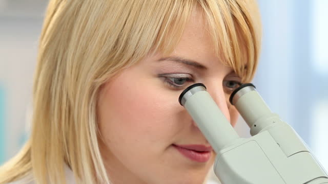 Scientist using a microscope video