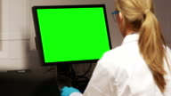 Scientist using computer with chroma key screen video