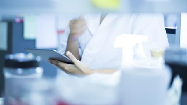 Scientist using digital tablet in laboratory video