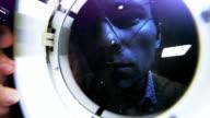 Scientist utilize a magnifier lamp inside the dark room video