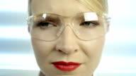 Scientist with a futuristic computer panel video