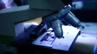 Scientist with microscope closeup shot in laboratory video