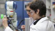 Scientist working with robotic arm video