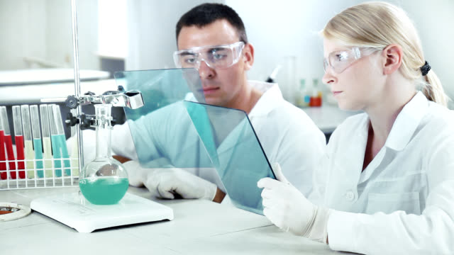 Scientists working in a chemical lab. video