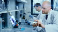 Scientists working in a laboratory video