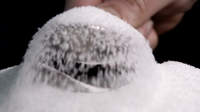 Scooping Up Granulated Sugar In Slow Motion video