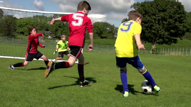 Scoring goal in Kid's Football / Soccer game video