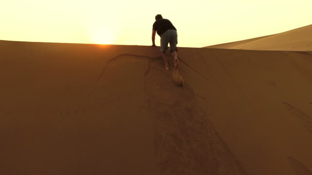 Scrambling over the dunes at dawn video