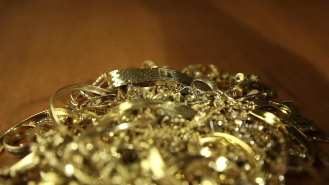 Scrap Gold Pile Exchanged for Money video