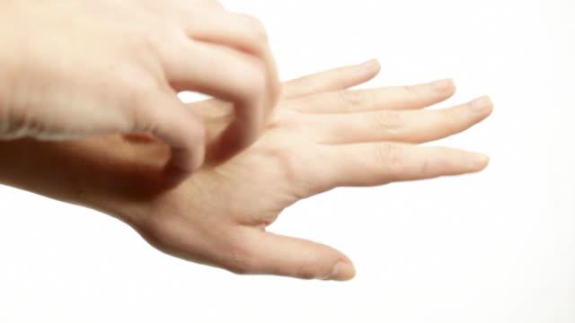 Scratching hands video