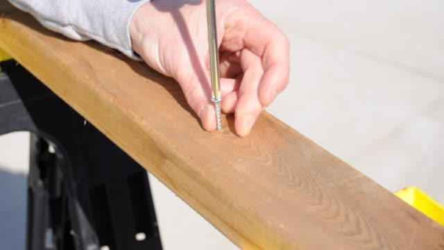 Screwing into a wood board video