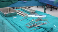 scrub nurse preparing surgical instruments for operation video