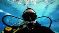 Scuba diver in a swimming pool video