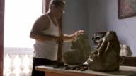 Sculptor, artist, art, craftsman, artisan working, man using hammer video