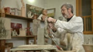 HD DOLLY: Sculptor Artist Modeling Clay video