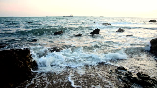 Sea beach and stones with sunset video