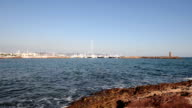 Sea, Lighthouse and harbor video
