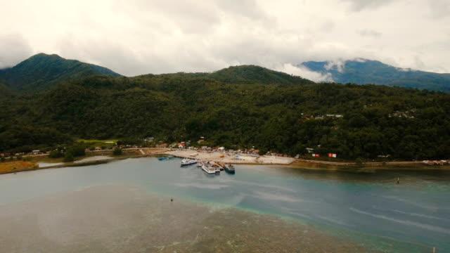 Sea passenger ferry port aerial view .Camiguin island, Philippines video