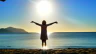 Sea. Sunrise. The girl on the beach greets the sunrise video