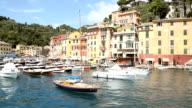 Sea town of Portofino and boats in port, Italy video