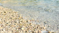 Sea water and pebbles video