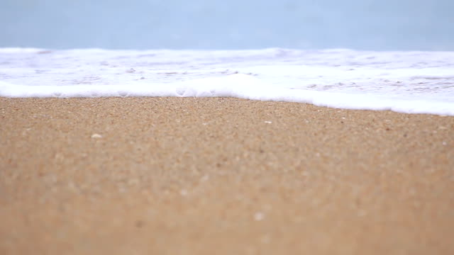 Sea wave on the sand of the tropical beach. video