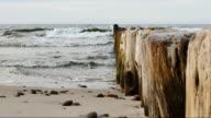 Sea waves breaking on the breakwater video