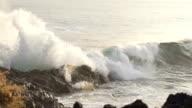 SLOW MOTION: sea waves splashing on rocks video