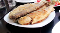 Seafood Cooked Fried Fish Trout on a Plate in a Restaurant video