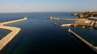Seagulls over harbour and fort of Lagos, Algarve, Portugal aerial view video