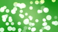 Seamless Looping White Large Particles on Green Abstract Background Motion video