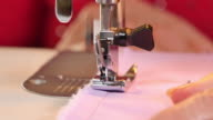 Seamstress Sews Clothes with her Sewing Machine video