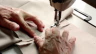 Seamstress using Sewing Machine hands focus video