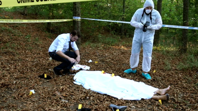 Searching for evidence on murder scene video