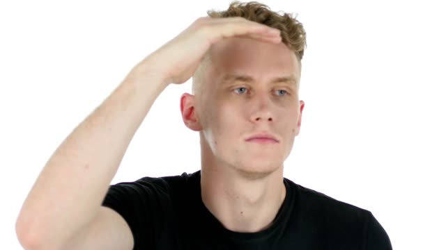 Searching Gesture by Young Man on White Background video