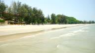seascape scenic in prachuapkhirikhan, thailand with wave crashing on sandy shore. video
